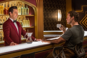 Jim (CHRIS PRATT) chats with bartender Arthur (MICHAEL SHEEN) at the Grand Concourse Bar in Columbia Pictures' PASSENGERS.